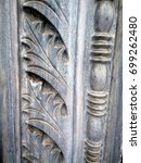Small photo of Architectural detail of a marble column. Acanthus is one of the most common plant forms to make foliage ornament and decoration.
