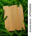 blank wooden board against pine ... | Shutterstock . vector #699266806