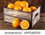 fresh oranges in a crate   Shutterstock . vector #699268330