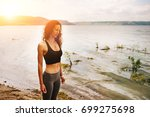 a beautiful sporty woman... | Shutterstock . vector #699275698