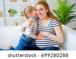 girl expecting a sister | Shutterstock . vector #699280288