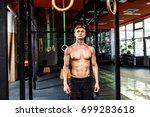 intense workout in dark gym ... | Shutterstock . vector #699283618