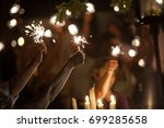 sparklers at night at an event. ...   Shutterstock . vector #699285658