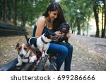Stock photo dog walker with dogs enjoying in park 699286666
