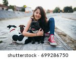 Stock photo dog walker with dogs enjoying outdoors next to city river 699286750