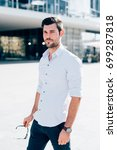 Small photo of young bearded businessman outdoor posing looking camera - ambition, business attire, attitude concept