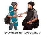 two happy skateboarders... | Shutterstock . vector #699292570