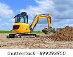 Small photo of The modern excavator performs excavation work on the construction site
