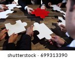 business people and puzzle on... | Shutterstock . vector #699313390