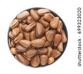 closeup pine nuts on  bowl... | Shutterstock . vector #699323020