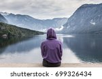 solitary woman wearing purple... | Shutterstock . vector #699326434