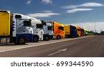 multicolored trucks standing in ...   Shutterstock . vector #699344590
