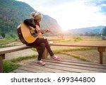 traveler asian women playing... | Shutterstock . vector #699344800