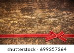 christmas background with bow | Shutterstock . vector #699357364
