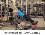 young fit woman in a fitness... | Shutterstock . vector #699365869