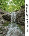 waterfall pool landscape | Shutterstock . vector #699370339