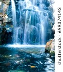 waterfall with water in motion. | Shutterstock . vector #699374143