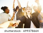 ecstatic girl and her friends... | Shutterstock . vector #699378664