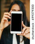 a phone with a blank  screen in ... | Shutterstock . vector #699379300