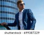 businessman in the car. luxury...   Shutterstock . vector #699387229