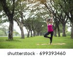 young woman practicing yoga in