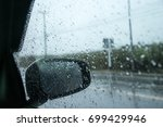 drops of rain on the car window ... | Shutterstock . vector #699429946