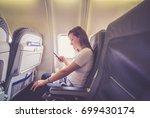 girl tourist traveller sit on... | Shutterstock . vector #699430174