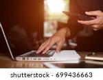 asian business man using ... | Shutterstock . vector #699436663