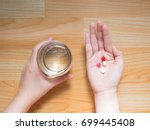 female patient taking medicine... | Shutterstock . vector #699445408