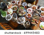 barbecue seafood and pork buffet | Shutterstock . vector #699445483
