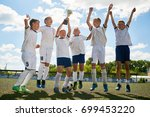 portrait of junior football... | Shutterstock . vector #699453220
