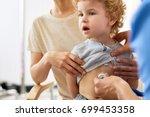 portrait of cute curly boy... | Shutterstock . vector #699453358