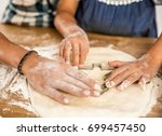 close up shot of hands on the... | Shutterstock . vector #699457450