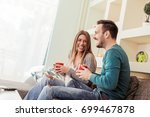 couple in love enjoying their... | Shutterstock . vector #699467878