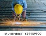 Worker Is Welding Rebar Shear...