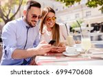 dating in the cafe. beautiful...   Shutterstock . vector #699470608