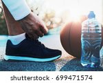 basketball player tying sport... | Shutterstock . vector #699471574