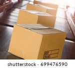 package boxes on conveyor belt... | Shutterstock . vector #699476590
