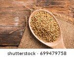 coriander seeds on a wooden... | Shutterstock . vector #699479758