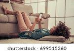 beautiful afro american girl is ... | Shutterstock . vector #699515260
