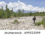 Inspection Of Dry Riverbed By...