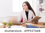 confident young business woman... | Shutterstock . vector #699527668