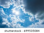 the sun is surrounded by rain... | Shutterstock . vector #699535084
