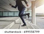 businessman running up the... | Shutterstock . vector #699558799