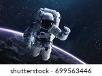 astronaut. deep space image ... | Shutterstock . vector #699563446