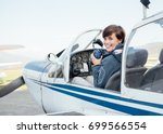 smiling female pilot in the... | Shutterstock . vector #699566554