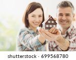 happy couple holding their...   Shutterstock . vector #699568780