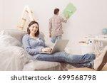 happy couple doing home... | Shutterstock . vector #699568798