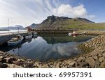 Boat,mountain, reflection in Iceland - stock photo