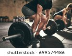 fit people doing deadlift... | Shutterstock . vector #699574486